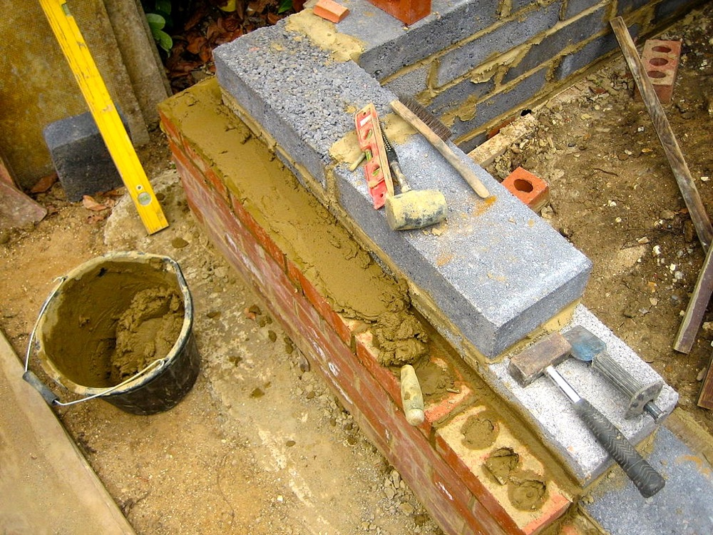 "<a href=""https://commons.wikimedia.org/wiki/File:Brick_and_block_laying.jpg"" target=""_new"">Image by Mark.murphy at English Wikipedia</a> released via <a href=""https://creativecommons.org/licenses/by-sa/3.0/"" target=""_blank"">Creative Commons CC BY-SA 3.0</a>"