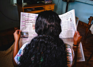 Photo of woman reading newspaper by Photo by Abhijith S Nair on Unsplash