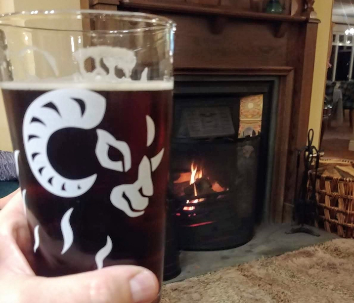 Real ale in front of a pub fire. Image by Media Helping Media released via Creative Commons BY-NC-SA 4.0